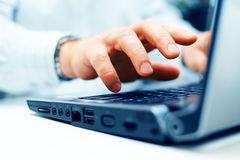 Closeup of man typing Stock Photo