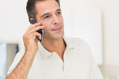 Closeup of a man using mobile phone at home Stock Image