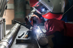 Closeup of man wearing mask welding in a workshop. Closeup of man wearing helmet welding in a workshop Royalty Free Stock Photos