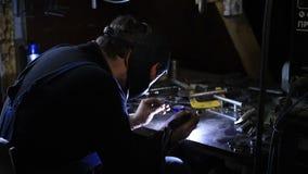 Closeup of man wearing mask welding in workshop stock video