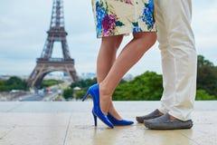 Closeup of man and woman legs near the Eiffel tower Stock Photos