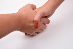 Closeup of man and woman shaking hands, isolated on white backg Stock Photo