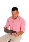 Closeup of man working on tablet pc. Stock Photography