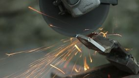 Man works circular saw. Flies of spark from hot metal. stock footage