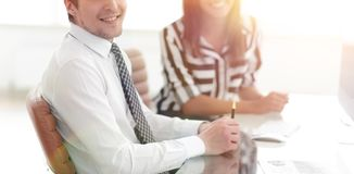 Closeup.Manager and client. Sitting in the office Royalty Free Stock Image