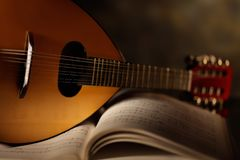 Mandolin with musical score stock photos