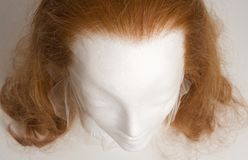 Closeup of Mannequin Female Head with Wig. From Above Stock Photo