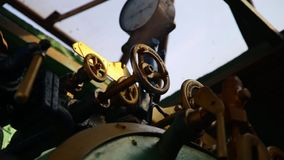 Closeup of manometer, pipes and faucet valves of steam train.  stock video footage