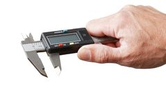 Closeup mans hand holds a electronic digital caliper. Isolated on white stock photography