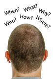 Closeup of mans head with questions. Stock Photos