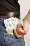 Closeup of many banknotes in jeans pocket Stock Photography