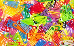 Many Colored Paper Clips on White. Stock Photo