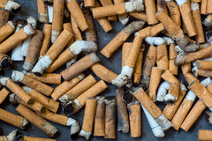 Closeup of many dirty cigarettes Royalty Free Stock Photo