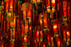 Closeup of many lit red lamps/lanterns in a temple Stock Photos