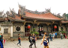 Closeup of many people in Longshan Temple ,Taiwan. Taiwan - Apr 15, 2017, Editorail use only; Closeup of many people in Longshan Temple ,Taiwan royalty free stock image