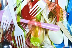 Colorful plastic spoons mixed up stock images