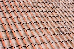 Closeup of many red clay roof tiles Stock Photos