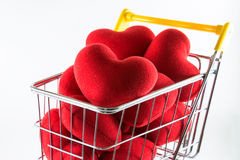 Closeup many red hearts in shopping cart Royalty Free Stock Photo