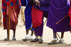 Closeup of Masai tribe. Closeup of legs and colorful textile of Masai tribe in Tanzania royalty free stock photos