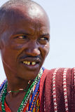 Closeup of a Masai warrior looking in the savanna Royalty Free Stock Photography