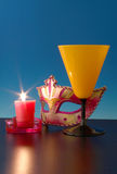 Closeup of mask with  Candle flame. Royalty Free Stock Photo