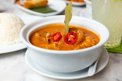 Massaman Duck Curry Served In Bowl At Restaurant Royalty Free Stock Photos
