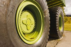 Giant Titan mining haul truck tires. Closeup of the massive tires on the giant Titan mining haul truck in Sparwood, BC, Canada Royalty Free Stock Photography