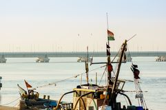 Closeup of mast, flag and cabin of boat in Diu royalty free stock photo