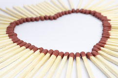 Closeup of match sticks arranged to form a heart shape Royalty Free Stock Photo