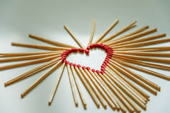 Closeup of matchsticks arranged to form a heart Royalty Free Stock Photo