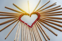 Closeup of matchsticks arranged to form a heart Stock Image