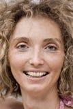 Closeup Of A Mature Blond Woman. Face Closeup Of A Mature Blond Curly Woman Royalty Free Stock Photography