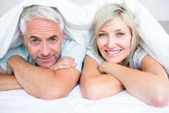 Closeup of a mature couple lying in bed Royalty Free Stock Photos