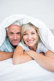 Closeup of a mature couple lying in bed Stock Photography