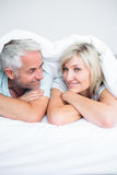 Closeup of a mature couple lying in bed Stock Photo