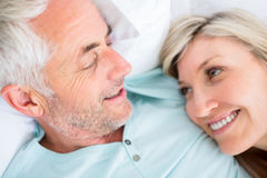 Closeup of a mature couple lying in bed Royalty Free Stock Images