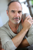 Closeup of mature man at home looking at camera. Portrait of handsome mature man at home royalty free stock photos