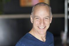 Closeup Of A Mature Man Smiling Stock Photography