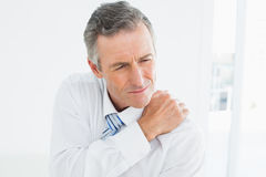 Closeup of a mature man suffering from shoulder pain Royalty Free Stock Image
