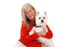 Closeup of Mature Woman Holding Dog Royalty Free Stock Image