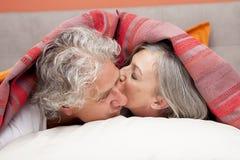 Closeup of mature woman kissing his partner Royalty Free Stock Images