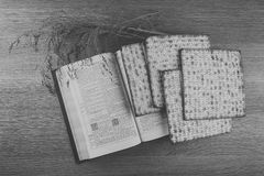 Closeup of Matzah bread served at Jewish Passover dinners. Closeup of Matzah on wooden table which is the unleavened bread served at Jewish Passover dinners Royalty Free Stock Photo