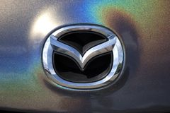 Closeup of Mazda Motor Corporation brand logo. Chrome car emblem sign. Tuning Show, Tomsk, Russia 2019-06-15.  royalty free stock image