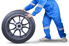 Closeup of mechanic holding tire Royalty Free Stock Image