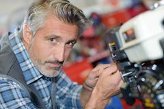 Closeup mechanic working on petrol engine. Closeup of mechanic working on petrol engine stock photos