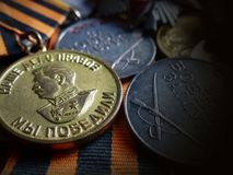 Medal `For the victory over Germany. 1941-1945` and medals `For Battle Merit` on St. George Ribbon. Awards grandfather. Memory. Closeup medal `For the victory stock photos