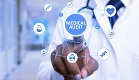 Closeup of medical audit button pressed by doctor royalty free stock photography