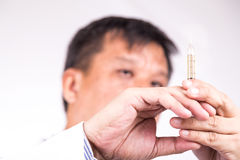 Closeup of medical doctor hand holding syringe for injection Stock Photography