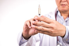 Closeup of medical doctor hand holding syringe for injection Royalty Free Stock Images