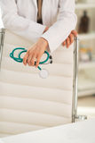 Closeup on medical doctor holding stethoscope Stock Photos